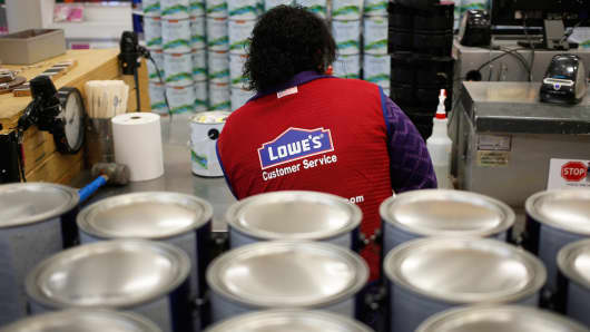 An employee works in the paint department at a Lowe's store in Louisville, Kentucky.