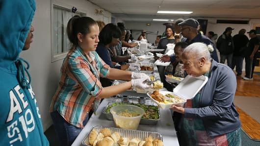 Volunteers serve free Thanksgiving meals at the Center of Hope Community Church in Oakland, Calif., in this Nov. 27, 2013 photo.