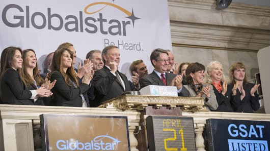Globalstar Chairman and CEO Jay Monroe rings the opening bell at the New York Stock Exchange, April 21, 2014.