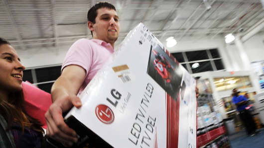 Shoppers carry away discounted items on Black Friday.