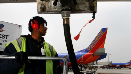 A Southwest Airlines plane getting fuel at Oakland International Airport.