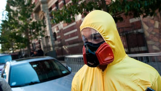 File photo: A young man, dressed in a biohazard costume, stands on the corner of 546 West 147th Street in October 2014 in New York City after an American doctor carrying the ebola virus was admitted to Bellevue Hospital