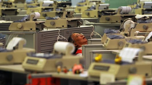 A trader sleeps at the Stock Exchange in Hong Kong