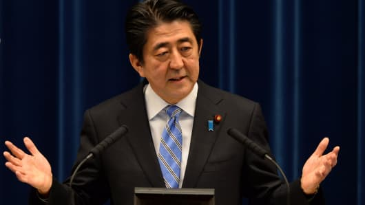 Shinzo Abe, Japan's prime minister, gestures as he speaks during a news conference at the prime minister's official residence in Tokyo, Japan, on Tuesday, Nov. 18, 2014.