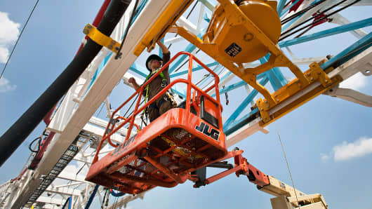A worker on a oil and gas drilling rig.