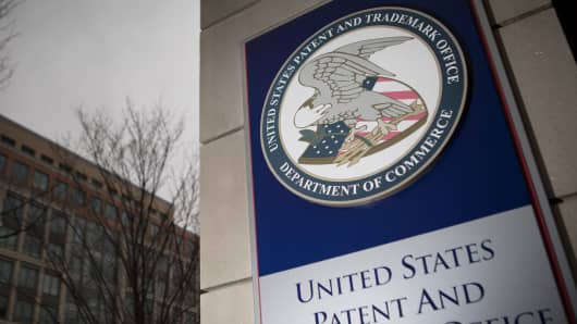 The U.S. Patent and Trademark Office (USPTO) seal is displayed outside the headquarters in Alexandria, Va.