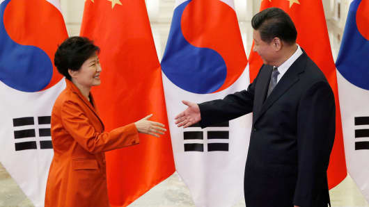 China's President Xi Jinping (R) shakes hands with South Korea's President Park Geun-hye during a meeting in Beijing, November 10, 2014.