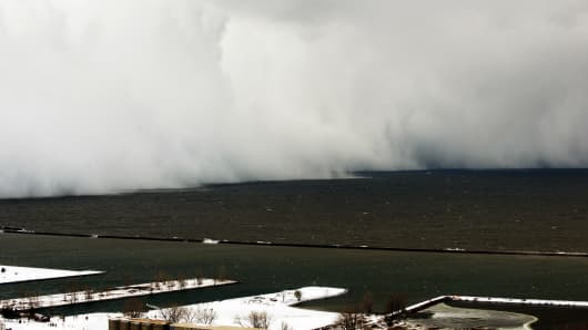 A lake-effect snow storm with freezing temperatures produces a wall of snow travelling over Lake Erie into Buffalo, New York. November 18, 2014.