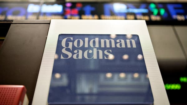 A Goldman Sachs sign hangs on the floor of the New York Stock Exchange.