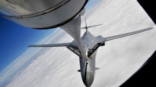 A KC-135 Stratotanker from Fairchild Air Force Base, Wash., refuels a B-1B Lancer during a training exercise Sept. 23, 2014, over South Dakota.