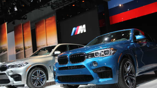 BMW M Series X5 and X6 (in blue) at the 2014 L.A. Auto Show.