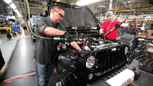 Workers assemble Jeep Wranglers at the Chrysler Toledo North Assembly Plant in Toledo, Ohio.