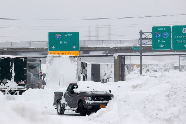 Vehicles litter the highway in West Seneca. An autumn blizzard dumped a year's worth of snow on western New York state where five people died and residents, some stranded overnight in cars, braced for another pummelling expected later on Wednesday.