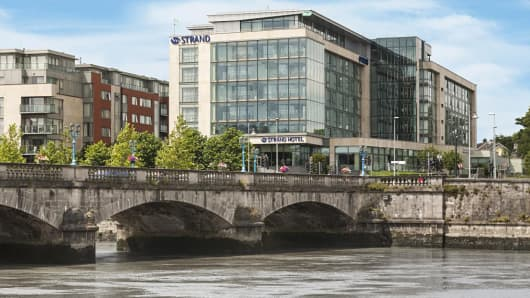 The Limerick Strand Hotel is shown near the banks of the River Shannon in Limerick, Ireland.