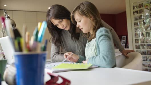 Mother looking at papers with daughter
