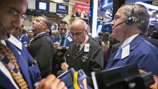 Traders work on the floor of the New York Stock Exchange, Nov. 18, 2014.