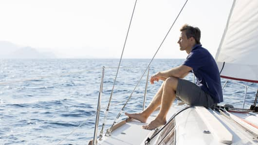 Wealth wealthy man on sailboat