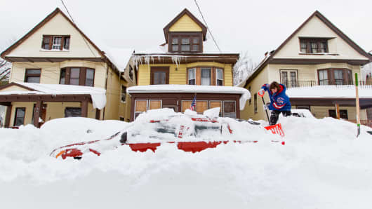 A resident shovels snow after a snowstorm in Buffalo, New York, November 20, 2014.