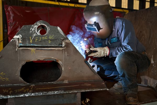 A welder works at the Orion Drilling manufacturing and fabrication facility in Corpus Christi, Texas.