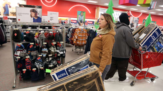 A customer shops for TV deals on Black Friday at Kmart in Griffith Indiana.