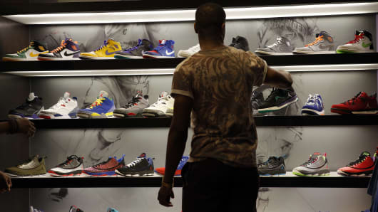 A shopper looks at sneakers at the House Of Hoops by Foot Locker retail store at the Beverly Center in Los Angeles.