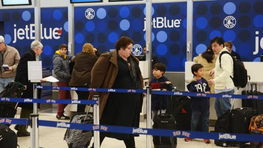 JetBlue passengers at Logan International Airport, Boston.