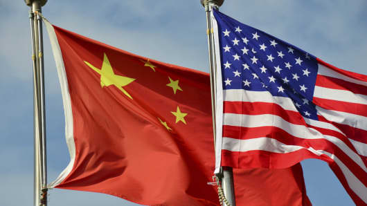 The flags of the U.S. and China.