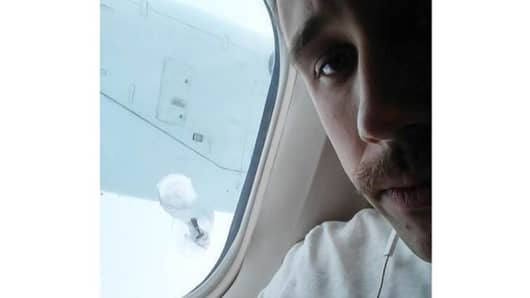A picture of the bolt lodged in the fuselage window.