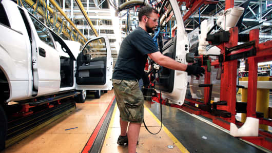 Ford worker on the assembly line at the Ford Dearborn Truck Plant, Dearborn, Michigan.