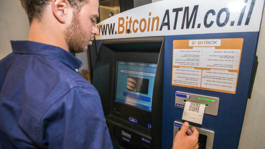A Israeli man buys Bitcoins at a Bitcoin ATM machine in Tel Aviv.