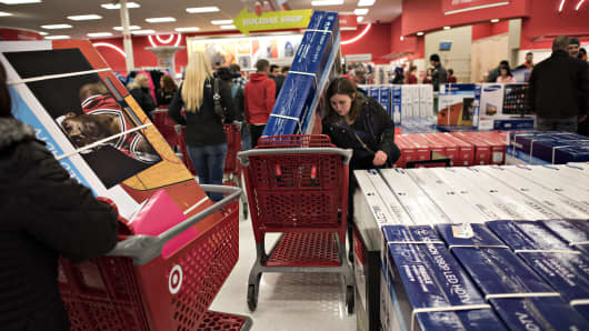 Customers load televisions into shopping carts at a Target Corp. store ahead of Black Friday in Mentor, Ohio, U.S., on Thursday, Nov. 27, 2014.