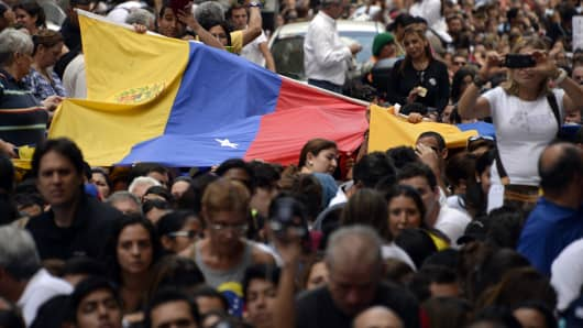 Anti-government demonstrators protest in eastern Caracas on February 27, 2014.