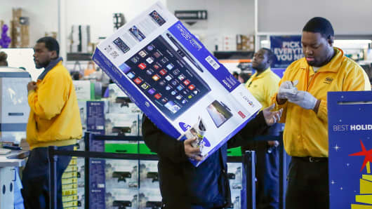 A shopper has his receipt checked before leaving a Best Buy store in Westbury, New York.