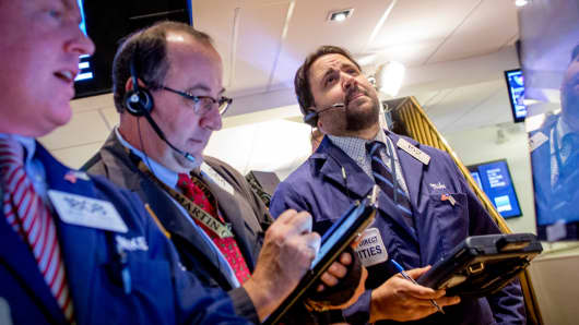 Traders on the floor of the New York Stock Exchange, December 1, 2014.