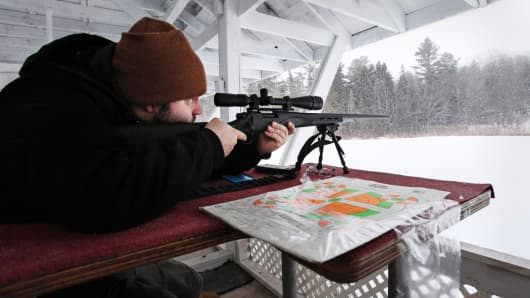 A shooter takes aim with a Remington Model 700 SPS Varmint rifle at the Spurwink Rod and Gun Club in Cape Elizabeth, Maine.