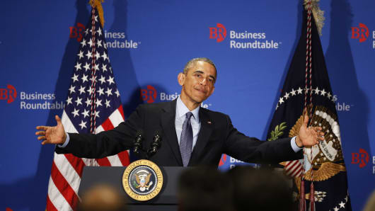 President Barack Obama gestures as he delivers remarks at the quarterly meeting of the Business Roundtable at the group's headquarters on Dec. 3, 2014, in Washington.