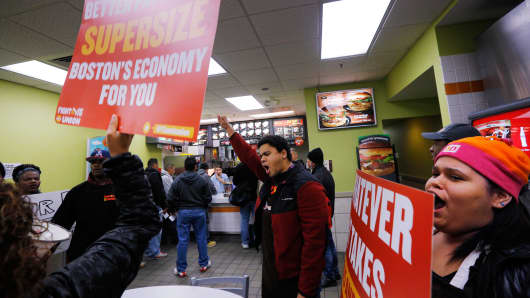 Fight for 15 campaigners protesting in a McDonald's restaurant in Massachusetts on December 4, 2014.