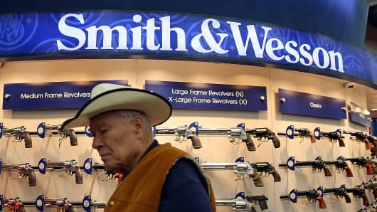 An attendee walks through the Smith and Wesson booth during the 2013 NRA Annual Meeting and Exhibits in Houston, May 3, 2013.