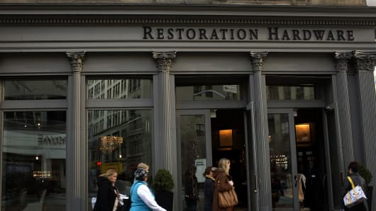 Pedestrians pass a Restoration Hardware store in New York.