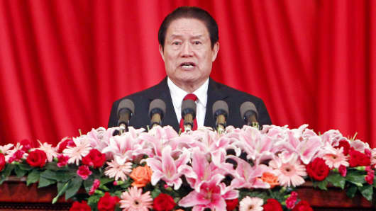 In this May 18, 2012 photo, security chief Zhou Yongkang delivers a speech at a meeting in Beijing.