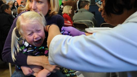 File photo of a young girl receiving and H1N1 vaccination in Washington, D.C.