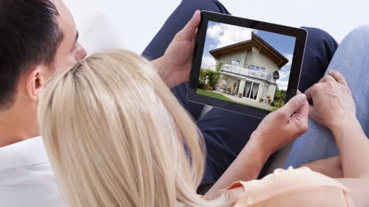 real estate millennials couple shopping for new home