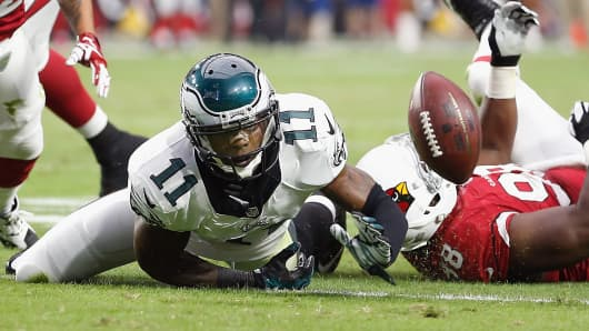 Wide receiver Josh Huff #11 of the Philadelphia Eagles fumbles the football forced by defensive end Frostee Rucker #98 of the Arizona Cardinals in the second quarter during the NFL game at the University of Phoenix Stadium on October 26, 2014 in Glendale, Arizona.