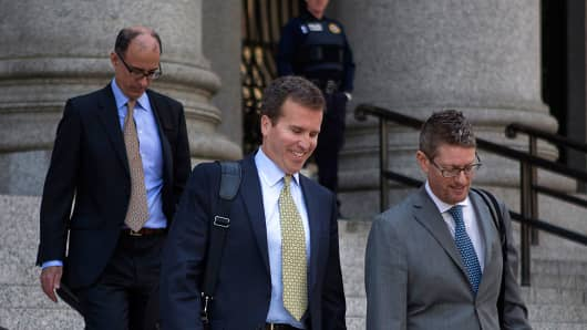 File photo: Todd Newman (center) leaving court with his attorney last year.
