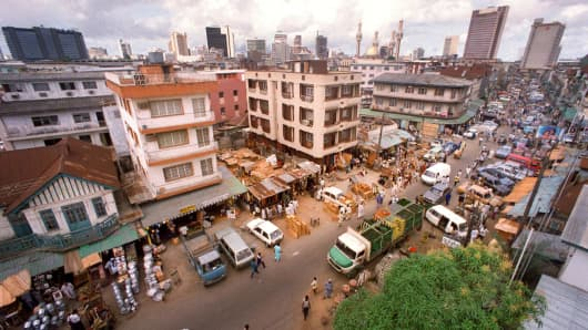 Jankara market, located on Lagos Island and the skyline of Lagos, Nigeria.