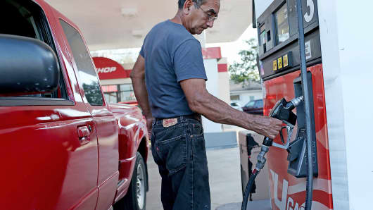 A customer refuels his vehicle at a U-gas station in Miami.
