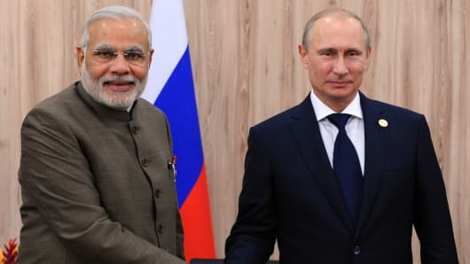 Narendra Modi with Vladimir Putin on the sidelines of the BRICS summit in Brazil, on July 16, 2014.