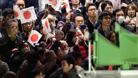 Supporters of the ruling Liberal Democratic Party (LDP) at a rally as Prime Minister and ruling LDP leader Shinzo Abe delivers a campaign speech at Omiya, suburban Tokyo on December 9, 2014