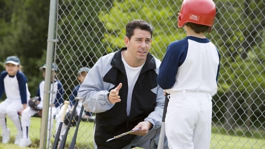 Baseball player pounds his coach