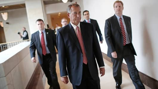 House Speaker John Boehner, R-Ohio, departs a press conference on Capitol Hill in Washington, Dec. 11, 2014.